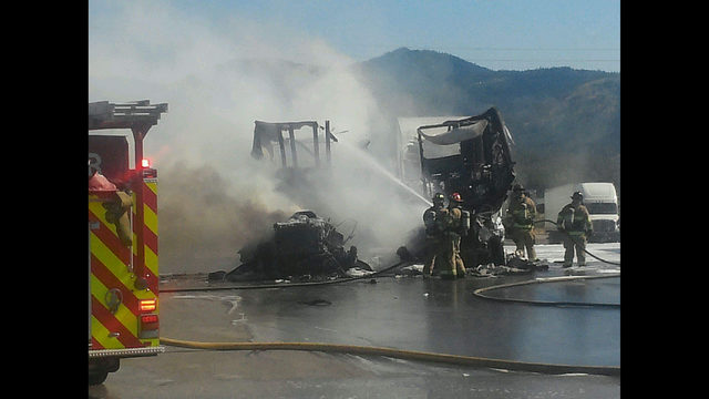 Fire involving two semi trucks at gas station in Post Falls