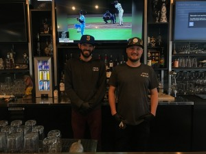 Joes House Owners Behind The Bar