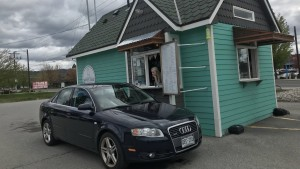 White Dog Coffee Exterior With Black Car