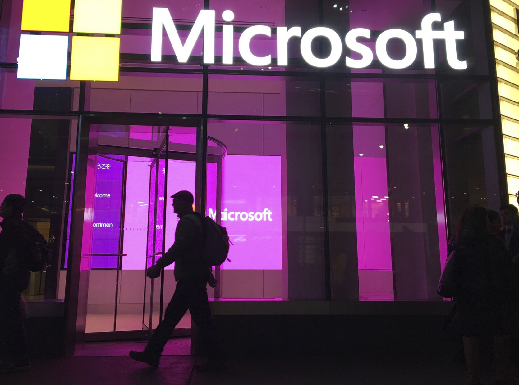 <p>In this Nov. 10, 2016, file photo, people walk near a Microsoft office in New York.</p>