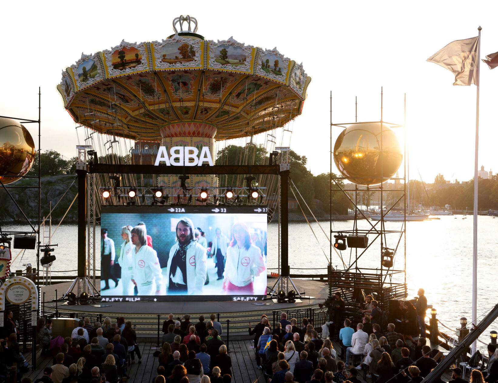 <p>People look at the screen at the ABBA Voyage event at Grona Lund in Stockholm, Sweden, on Thursday.</p>