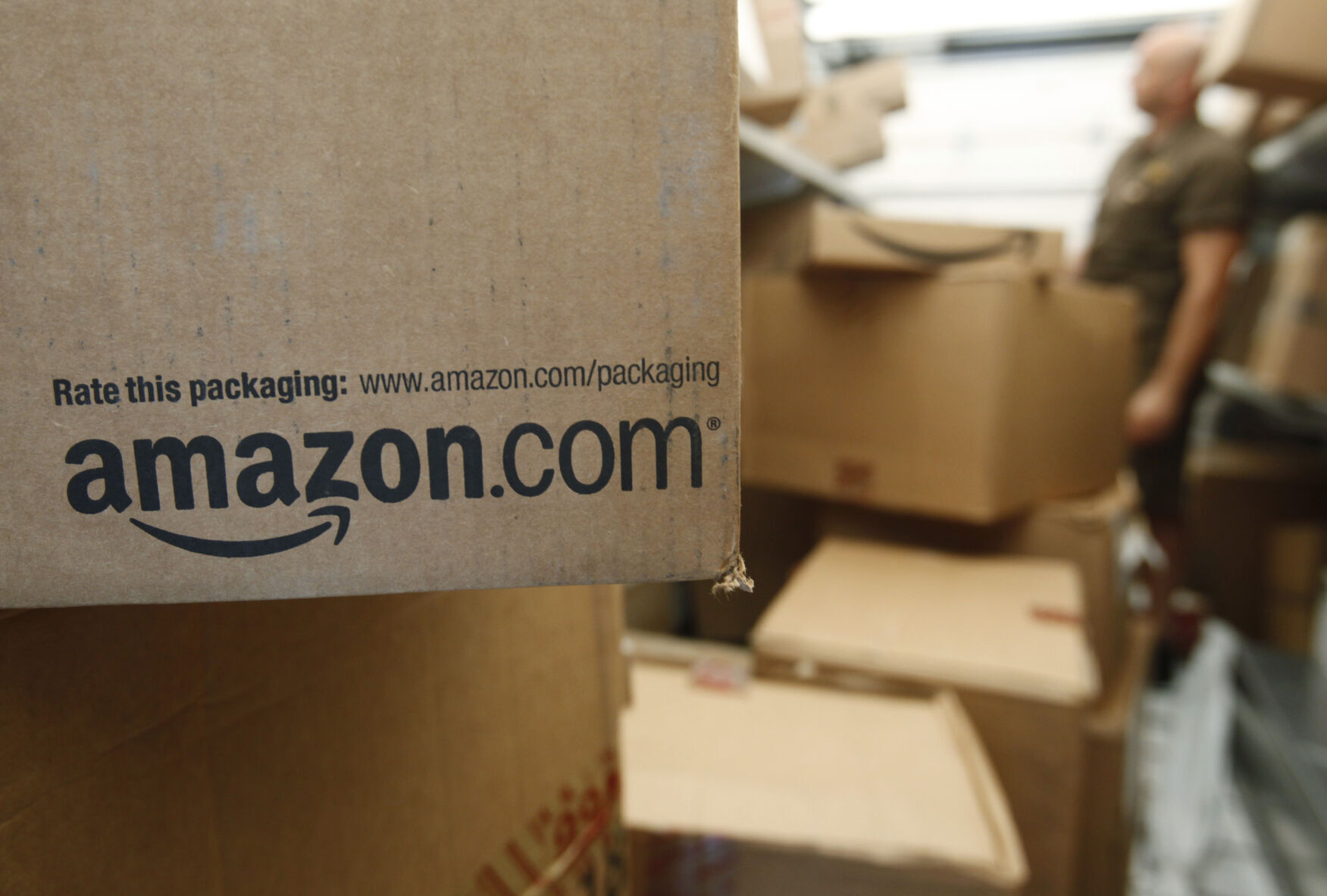 <p>In this Oct. 18, 2010 photo, an Amazon.com package awaits delivery from UPS in Palo Alto, Calif. (AP Photo/Paul Sakuma)</p>