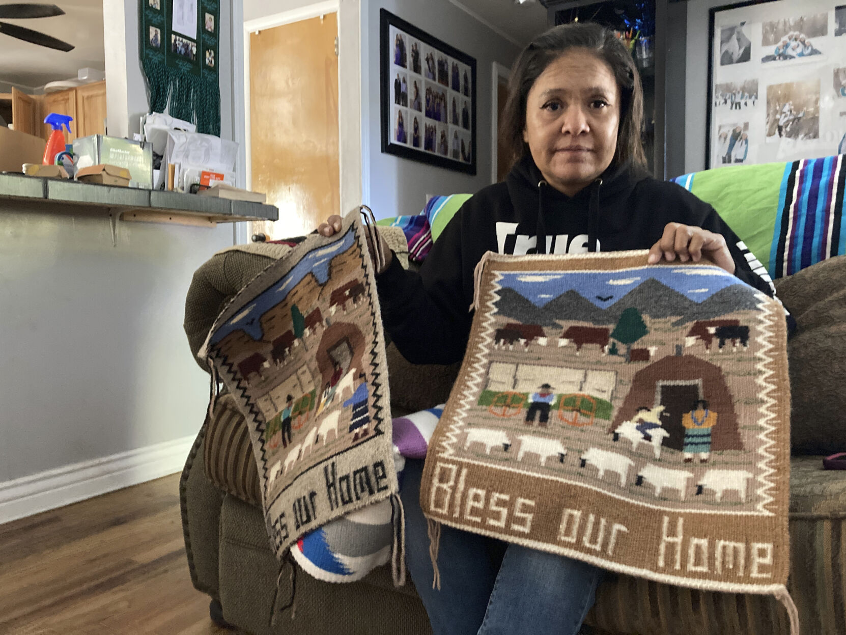 <p>Seraphine Warren poses for a photo in her home in Tooele, Utah, on Sept. 23, 2021, with a rug made by her aunt, Navajo rug weaver Ella Mae Begay. Begay, 62, disappeared in June, one of thousands of missing Indigenous women across the U.S. The extensive coverage of the Gabby Petito case is renewing calls to also shine a spotlight on missing people of color.</p>