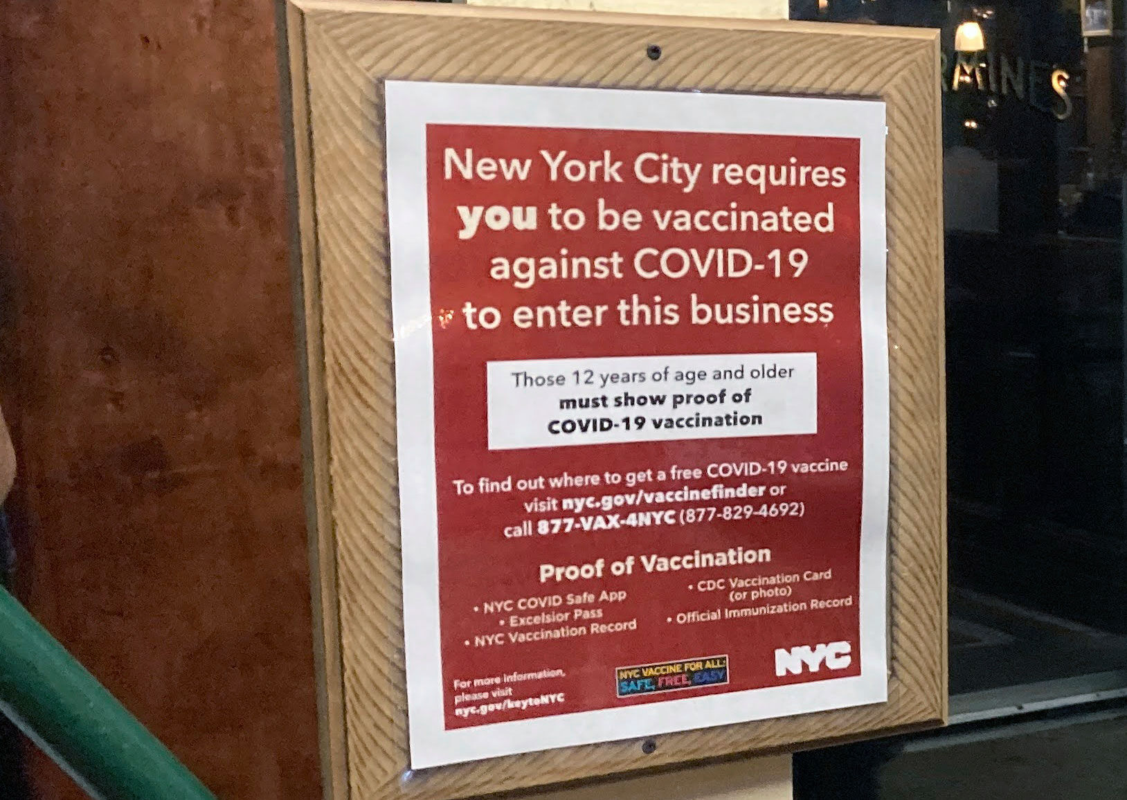 <p>A sign informs customers they must show proof of vaccination against COVID-19 to dine indoors at Carmine's Italian restaurant on the Upper West Side of Manhattan in New York City.</p>
